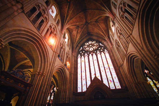 The epic south window, the beautiful colour and detail is lost here but the warmth of the cathedral and ornate ceiling wrap around it with their own towering majesty.